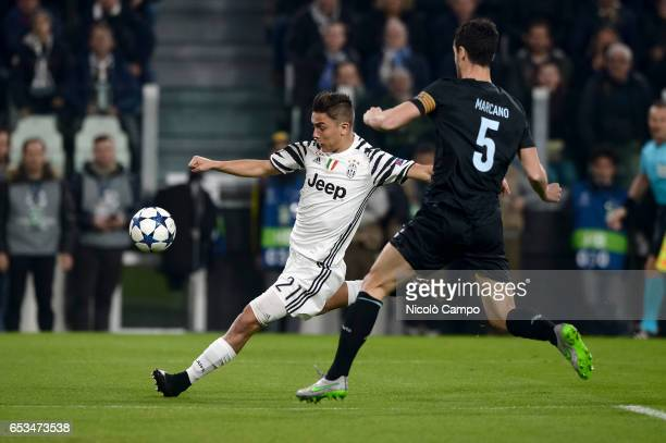 Paulo Dybala of Juventus FC and Ivan Marcano of FC Porto compete for the ball during the UEFA Champions League football match between Juventus FC and...
