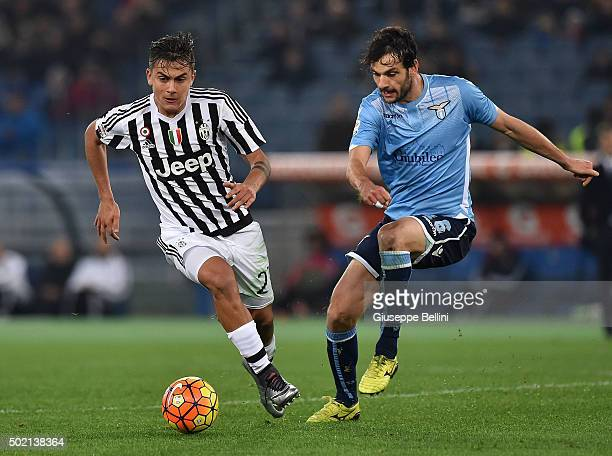 Paulo Dybala of Juventus FC and Marco Parolo of SS Lazio in action during the Serie A match between SS Lazio and Juventus FC at Stadio Olimpico on...
