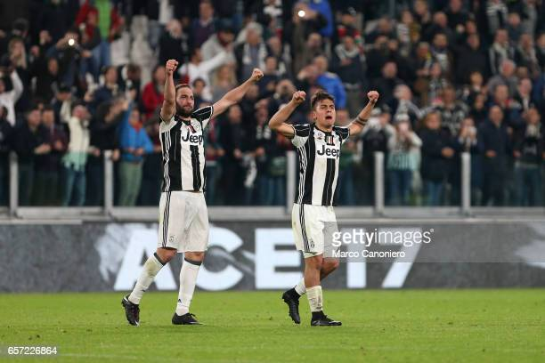 Paulo Dybala of Juventus Fc celebrate victory with teammates Gonzalo Higuain at the and of the Serie A football match between Juventus FC and Ac...
