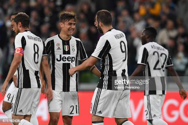 Paulo Dybala of Juventus FC celebrates a goal with team mate Gonzalo Higuain during the Serie A match between Juventus FC and Genoa CFC at Juventus...