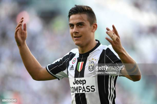 Paulo Dybala of Juventus FC celebrates after beating FC Crotone 30 to win the Serie A Championships at the end of the Serie A match between Juventus...