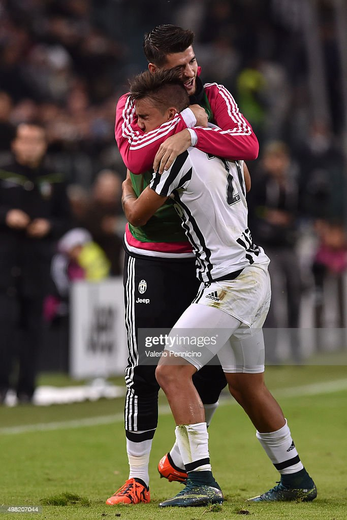 Paulo Dybala (L) of Juventus FC celebrates after scoring the opening goal with team mate Alvaro Morata during the Serie A match between Juventus FC and AC Milan at Juventus Arena on November 21, 2015 in Turin, Italy.