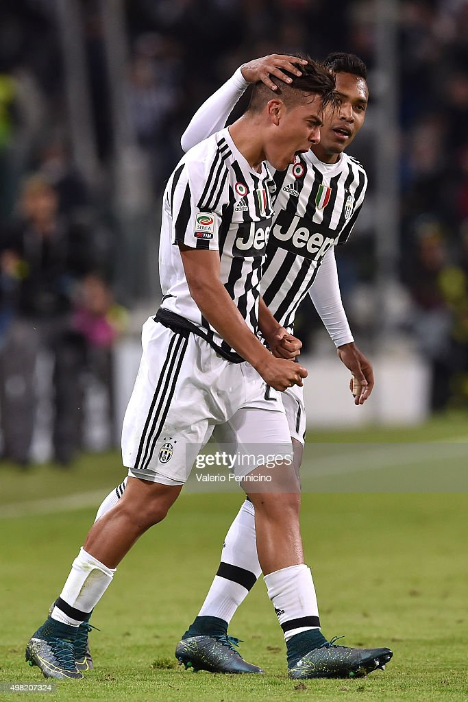 Paulo Dybala (L) of Juventus FC celebrates after scoring the opening goal with team mate Alex Sandro during the Serie A match between Juventus FC and AC Milan at Juventus Arena on November 21, 2015 in Turin, Italy.