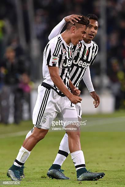 Paulo Dybala of Juventus FC celebrates after scoring the opening goal with team mate Alex Sandro during the Serie A match between Juventus FC and AC...