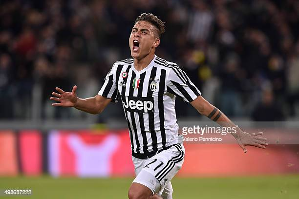 Paulo Dybala of Juventus FC celebrates after scoring the opening goal during the Serie A match between Juventus FC and AC Milan at Juventus Arena on...