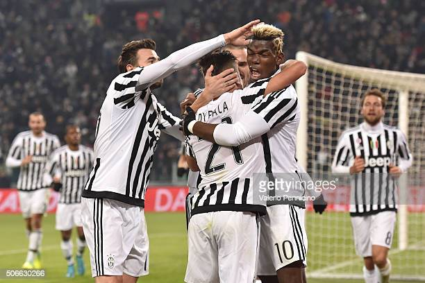 Paulo Dybala of Juventus FC celebrates after scoring the opening goal with team mate Paul Pogba during the Serie A match between Juventus FC and AS...