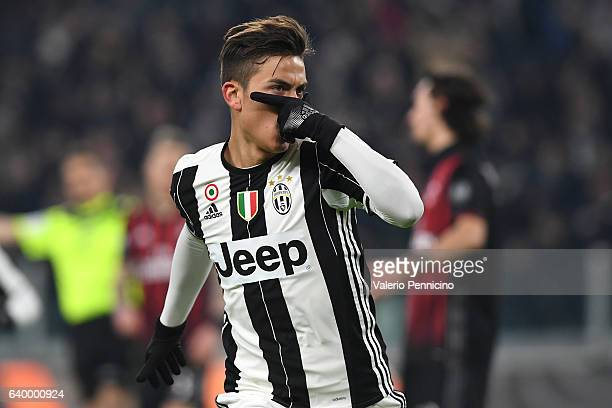 Paulo Dybala of Juventus FC celebrates after scoring the opening goal during the TIM Cup match between Juventus FC and AC Milan at Juventus Stadium...