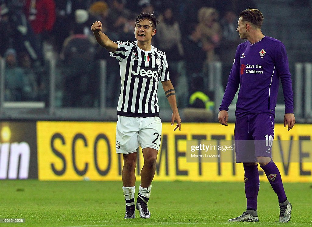 Paulo Dybala (L) of Juventus FC celebrates his goal during the Serie A match betweeen Juventus FC and ACF Fiorentina at Juventus Arena on December 13, 2015 in Turin, Italy.