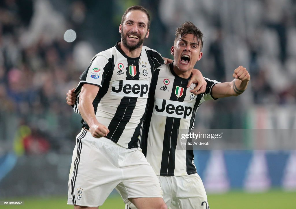Paulo Dybala of Juventus FC (R) celebrates his goal with his team-mate Gonzalo Higuain during the Serie A match between Juventus FC and AC Milan at Juventus Stadium on March 10, 2017 in Turin, Italy.