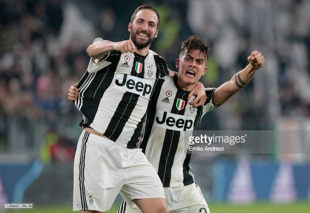 Paulo Dybala of Juventus FC celebrates his goal with his teammate Gonzalo Higuain during the Serie A match between Juventus FC and AC Milan at...
