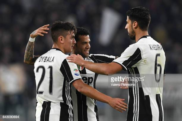 Paulo Dybala of Juventus FC celebrates his goal with team mates Daniel Alves and Sami Khedira during the Serie A match between Juventus FC and US...