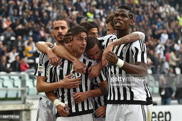 Paulo Dybala of Juventus FC celebrates the opening goal with team mates during the Serie A match between Juventus FC and Atalanta BC at Juventus...