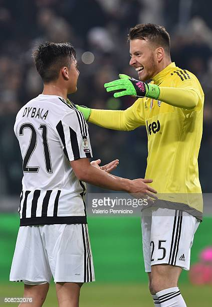 Paulo Dybala of Juventus FC celebrates victory with Norberto Murara Neto at the end of the TIM Cup match between Juventus FC and FC Internazionale...