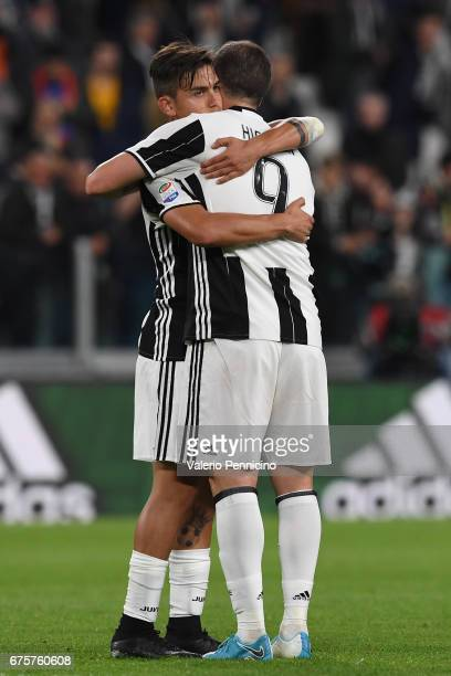 Paulo Dybala of Juventus FC celebrates victory with team mate Gonzalo Higuain at the end of the Serie A match between Juventus FC and Genoa CFC at...