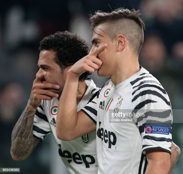 Paulo Dybala of Juventus FC celebrates with his teammate Daniel Alves da Silva after scoring the opening goal during the UEFA Champions League Round...