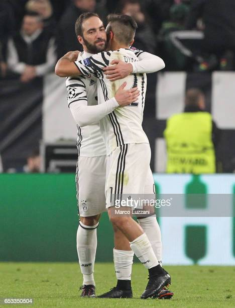 Paulo Dybala of Juventus FC celebrates with his teammate Gonzalo Higuain after scoring the opening goal during the UEFA Champions League Round of 16...