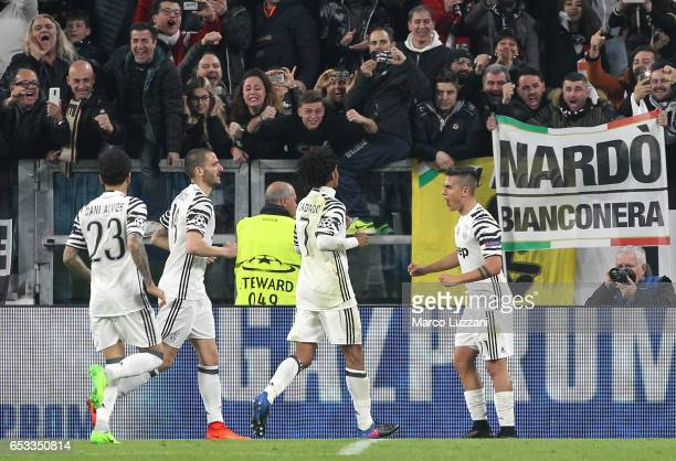 Paulo Dybala of Juventus FC celebrates with his teammates after scoring the opening goal during the UEFA Champions League Round of 16 second leg...
