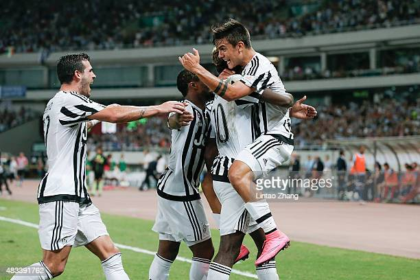 Paulo Dybala of Juventus FC celebrates with teammates after a goal during the Italian Super Cup final football match between Juventus and Lazio at...