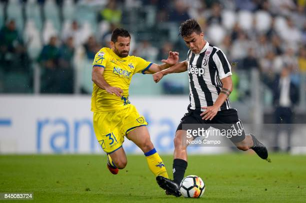 Paulo Dybala of Juventus FC compete for the ball with Sergio Pellissier of AC ChievoVerona during the Serie A football match between Juventus FC and...