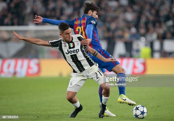 Paulo Dybala of Juventus FC competes for the ball with Andre Gomes of FC Barcelona during the UEFA Champions League Quarter Final first leg match...