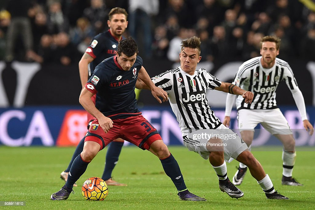 <a gi-track='captionPersonalityLinkClicked' href=/galleries/search?phrase=Paulo+Dybala&family=editorial&specificpeople=9572043 ng-click='$event.stopPropagation()'>Paulo Dybala</a> (R) of Juventus FC competes with Blerin Dzemaili of Genoa CFC during the Serie A match between Juventus FC and Genoa CFC at Juventus Arena on February 3, 2016 in Turin, Italy.
