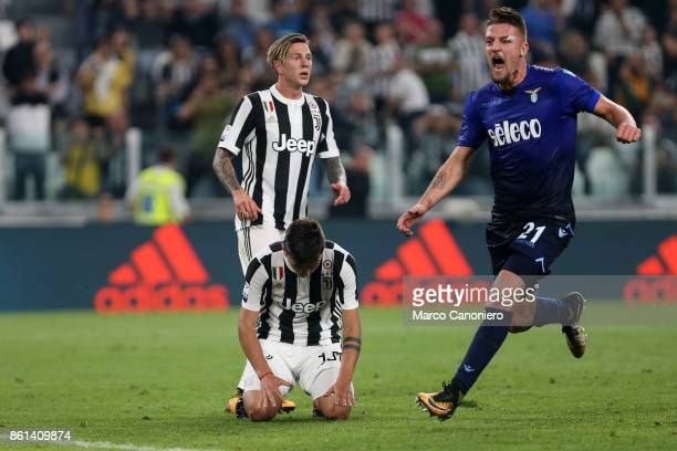 Paulo Dybala of Juventus FC despairs after missing a penalty while Sergej MilinkovicSavic of SS Lazio celebrate during the Serie A football match...