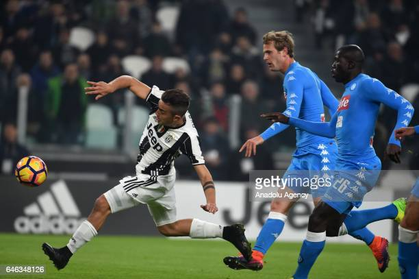 Paulo Dybala of Juventus FC in action against Ivan Strinic and Kalidou Koulibaly of SSC Napoli during the TIM Cup match between Juventus FC and SSC...