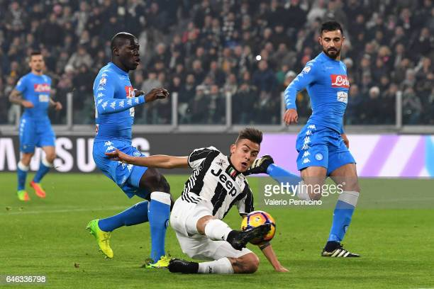 Paulo Dybala of Juventus FC in action against Kalidou Koulibaly of SSC Napoli during the TIM Cup match between Juventus FC and SSC Napoli at Juventus...