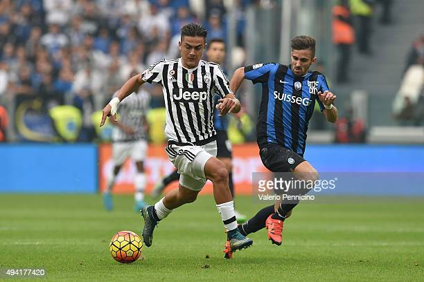 Paulo Dybala of Juventus FC in action against Marco D Alessandro of Atalanta BC during the Serie A match between Juventus FC and Atalanta BC at...