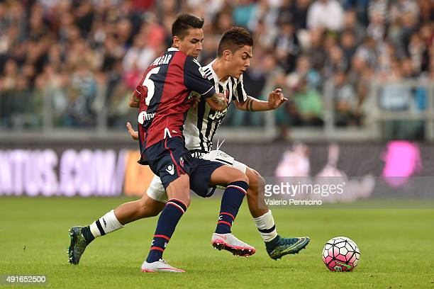 Paulo Dybala of Juventus FC is challenged by Erick Pulgar of Bologna FC during the Serie A match between Juventus FC and Bologna FC at Juventus Arena...