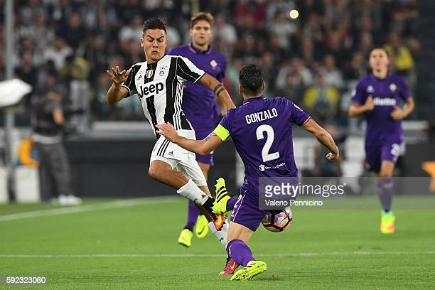 Paulo Dybala of Juventus FC is challenged by Gonzalo Rodriguez of ACF Fiorentina during the Serie A match between Juventus FC and ACF Fiorentina at...