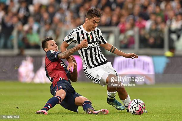 Paulo Dybala of Juventus FC is tackled by Erick Pulgar of Bologna FC during the Serie A match between Juventus FC and Bologna FC at Juventus Arena on...