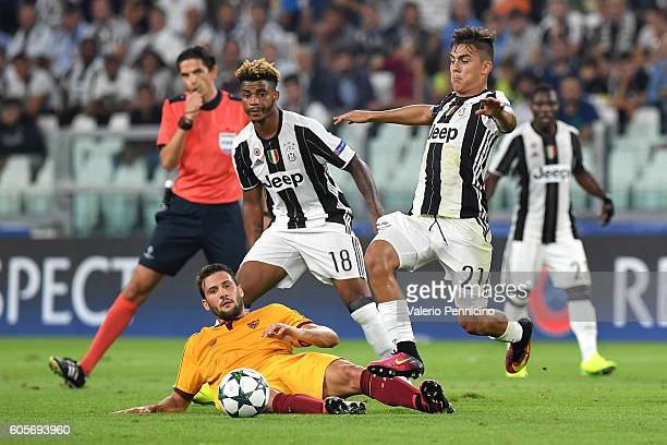 Paulo Dybala of Juventus FC is tackled by Franco Vazquez of Sevilla FC during the UEFA Champions League Group H match between Juventus FC and Sevilla...