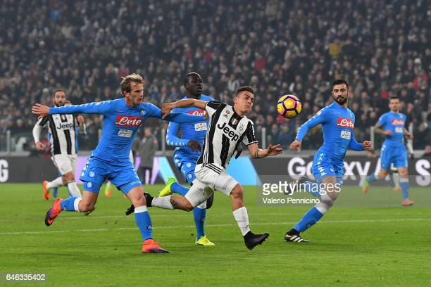 Paulo Dybala of Juventus FC is tackled by Ivan Strinic of SSC Napoli during the TIM Cup match between Juventus FC and SSC Napoli at Juventus Arena on...