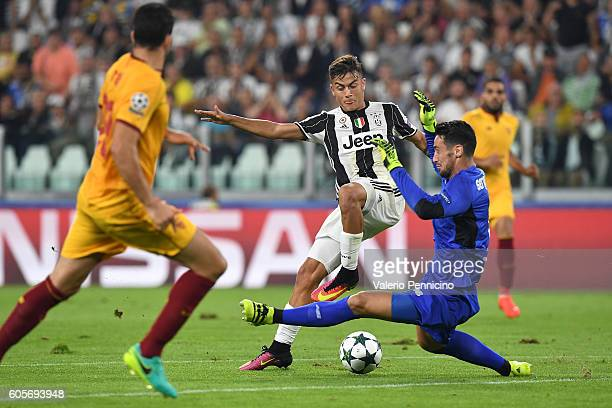 Paulo Dybala of Juventus FC is tackled by Sergio Rico of Sevilla FC during the UEFA Champions League Group H match between Juventus FC and Sevilla FC...