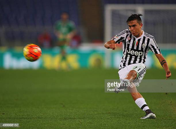 Paulo Dybala of Juventus FC kicks the ball during the Serie A match between SS Lazio and Juventus FC at Stadio Olimpico on December 4 2015 in Rome...