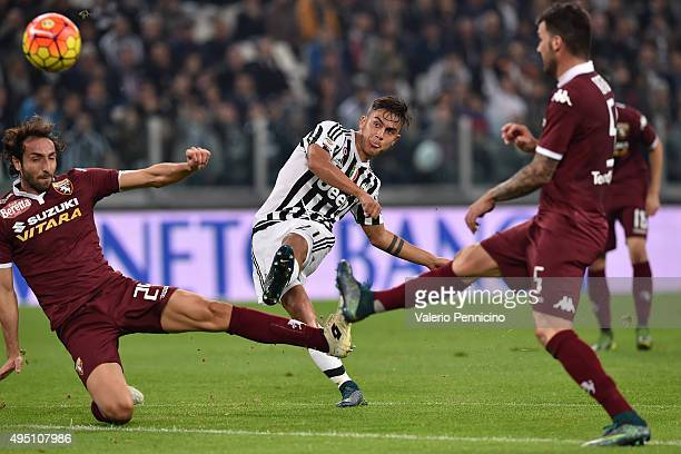Paulo Dybala of Juventus FC kiks the ball during the Serie A match between Juventus FC and Torino FC at Juventus Arena on October 31 2015 in Turin...