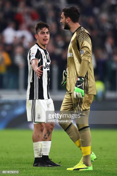Paulo Dybala of Juventus FC offers his hand to Gianluigi Donnarumma of AC Milan at the end of the Serie A match between Juventus FC and AC Milan at...