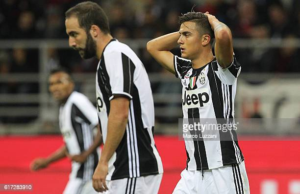Paulo Dybala of Juventus FC reacts to a missed chance during the Serie A match between AC Milan and Juventus FC at Stadio Giuseppe Meazza on October...