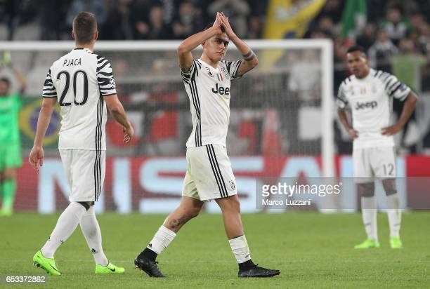 Paulo Dybala of Juventus FC salutes the fans during the UEFA Champions League Round of 16 second leg match between Juventus and FC Porto at Juventus...