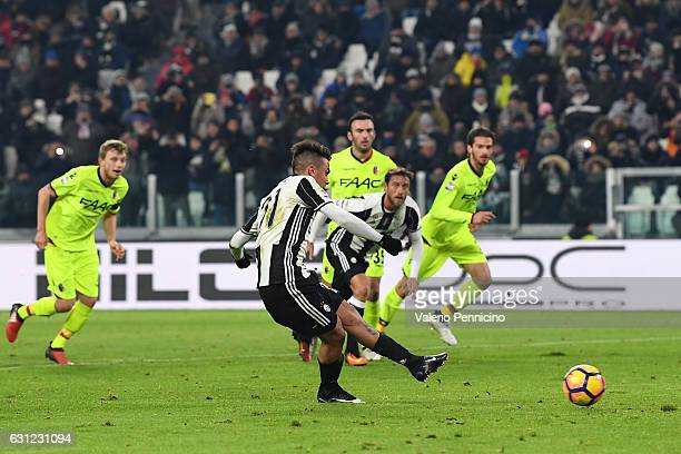 Paulo Dybala of Juventus FC scores a goal from the penalty spot during the Serie A match between Juventus FC and Bologna FC at Juventus Stadium on...