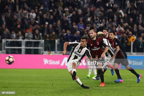 Paulo Dybala of Juventus FC scores a penalty in injury time to make the score 21 during the Serie A match between Juventus FC and AC Milan at...