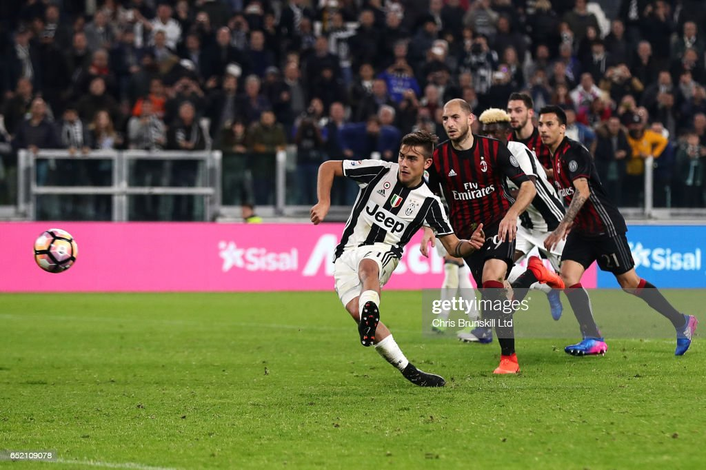 Paulo Dybala of Juventus FC scores a penalty in injury time to make the score 2-1 during the Serie A match between Juventus FC and AC Milan at Juventus Stadium on March 10, 2017 in Turin, Italy.