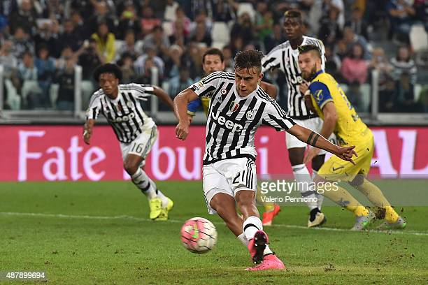 Paulo Dybala of Juventus FC scores his goal from the penalty spot during the Serie A match between Juventus FC and AC Chievo Verona at Juventus Arena...