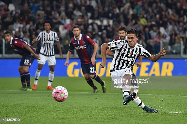Paulo Dybala of Juventus FC scores his goal from the penalty spot during the Serie A match between Juventus FC and Bologna FC at Juventus Arena on...