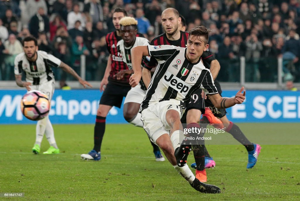 Paulo Dybala of Juventus FC scores his goal from the penalty spot during the Serie A match between Juventus FC and AC Milan at Juventus Stadium on March 10, 2017 in Turin, Italy.