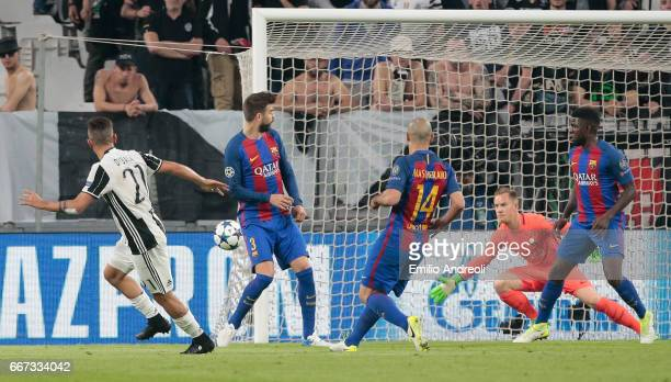 Paulo Dybala of Juventus FC scores his second goal during the UEFA Champions League Quarter Final first leg match between Juventus and FC Barcelona...