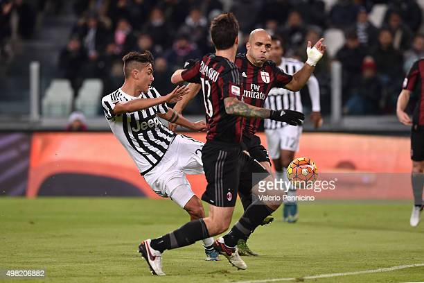 Paulo Dybala of Juventus FC scores the opening goal during the Serie A match between Juventus FC and AC Milan at Juventus Arena on November 21 2015...