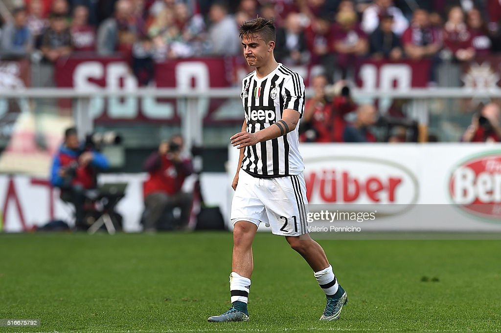 Paulo Dybala of Juventus FC walks off with an injury during the Serie A match between Torino FC and Juventus FC at Stadio Olimpico di Torino on March...
