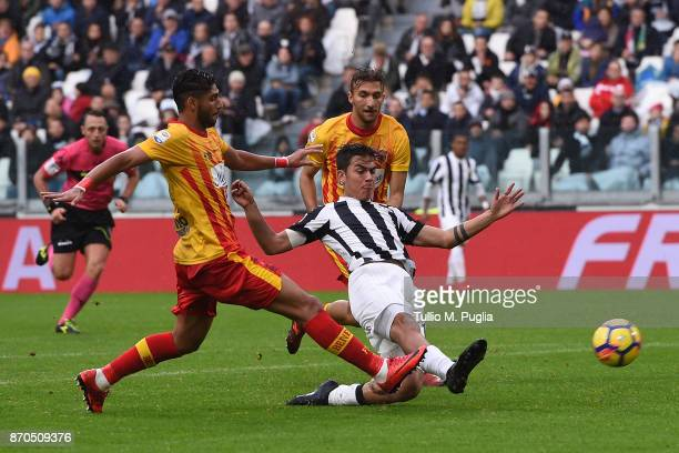 Paulo Dybala of Juventus is challenged by Achraf Lazaar of Benevento during the Serie A match between Juventus and Benevento Calcio on November 5...